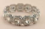 Clear/Silver Round Stone With Multi Stone Cluster Rim Stretch Bracelet