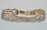 Clear/Gold One Small Round Stone Bracelet